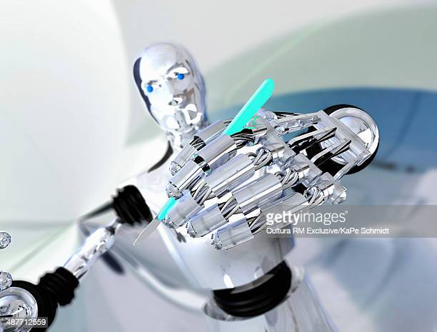 Robot holding up scalpel