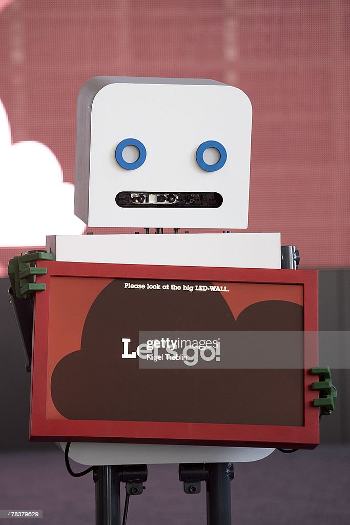 A robot holds a screen at the IBM stand at the 2014 CeBIT technology Trade fair on March 13, 2014 in Hanover, Germany. CeBIT is the world's largest technology fair and this year's partner nation is Great Britain.