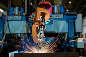 Robot is welding assembly automotive part in car factory