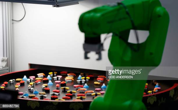 A robot made to pick up sushis is displayed at the CeBIT technology fair at its opening day on March 20 2017 in Hanover nothern Germany German...