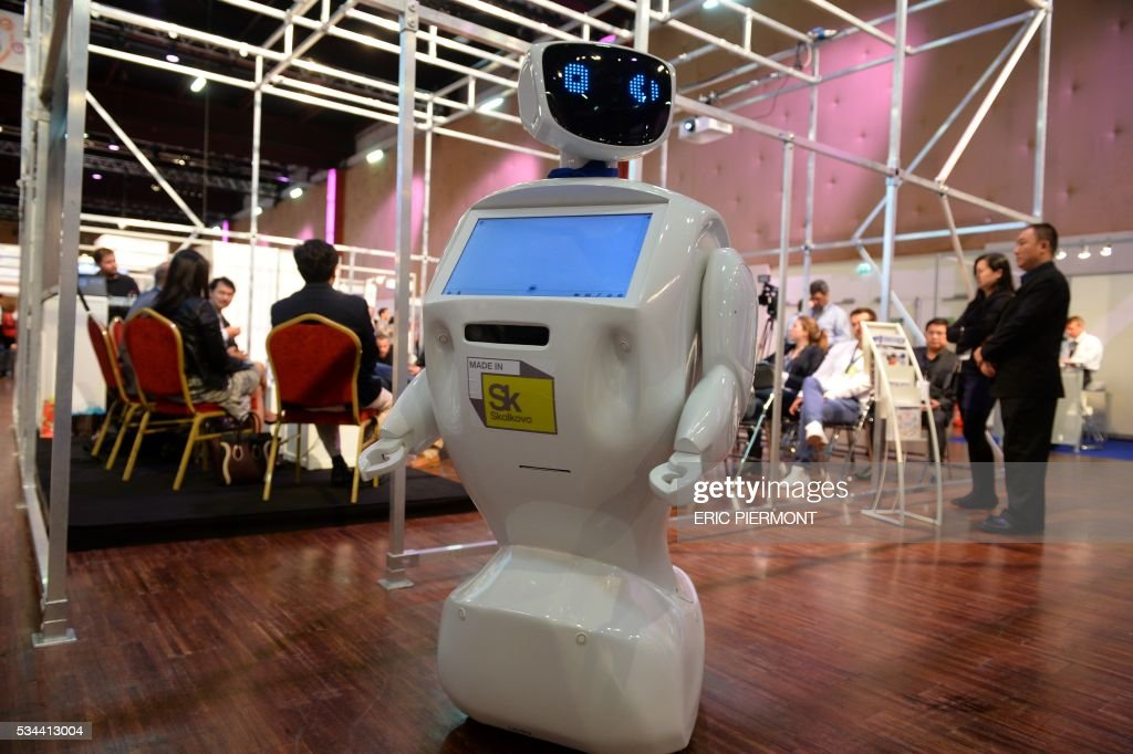 A robot moves among visitors at the Robotics event Innorobo in La Plaine Saint-Denis on May 26, 2016. / AFP / ERIC