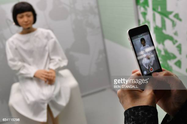A robot produced by Japan's Hiroshi Ishiguro Laboratories called 'Kodomoroid' Japan 2014 is on view at the ROBOT exhibition at the Science Museum in...
