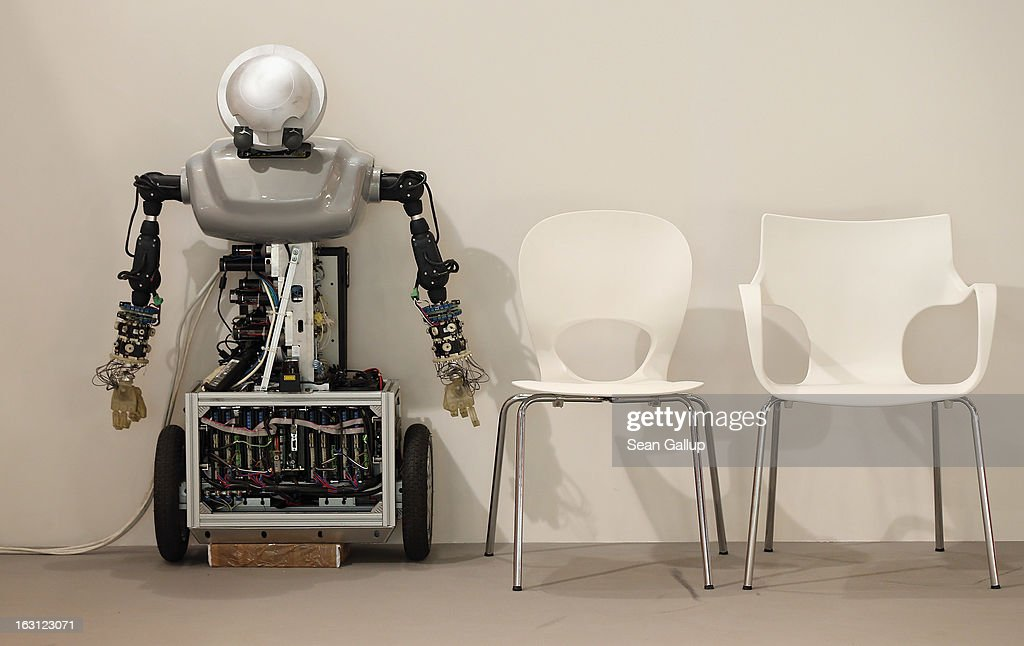 A robot rests next to empty chairs at the Poland country stand at the 2013 CeBIT technology trade fair on March 5, 2013 in Hanover, Germany. CeBIT will be open March 5-9.