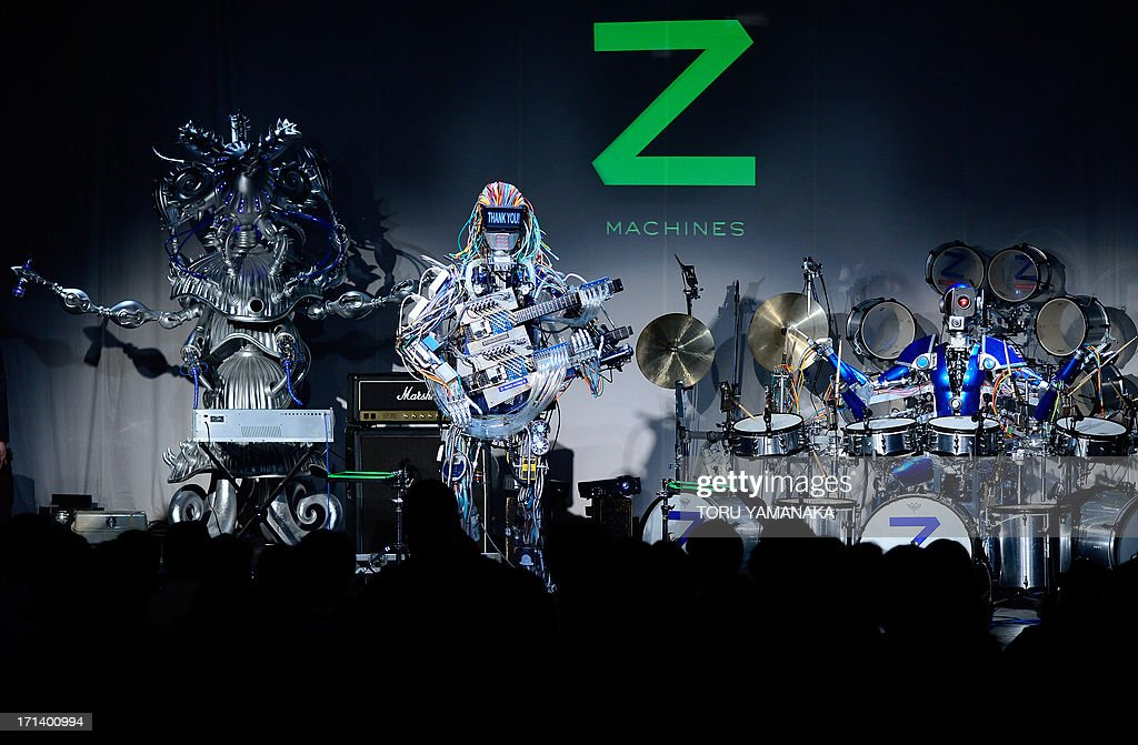 Robot rock band 'Z-MACHINES' performs during its debut concert in Tokyo on June 24, 2013. The robot band consists guitar robot 'Mach', drum robot 'Ashura' and keyboard robot 'Cosmo'. AFP PHOTO/Toru YAMANAKA
