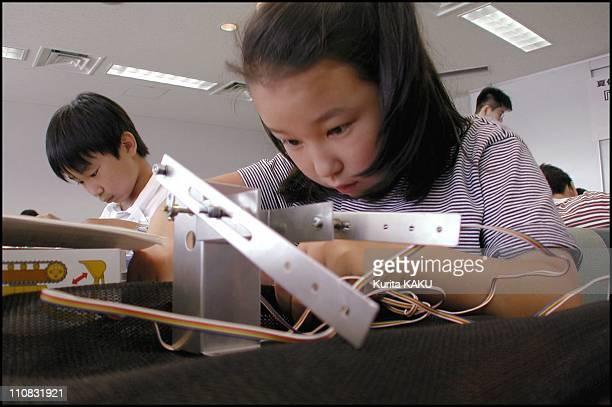 Robot School For Children In Summer In Tokyo Japan On June 24 2000 Robot school for children in summer Prof Akira Sato of Shibaura Industrial...