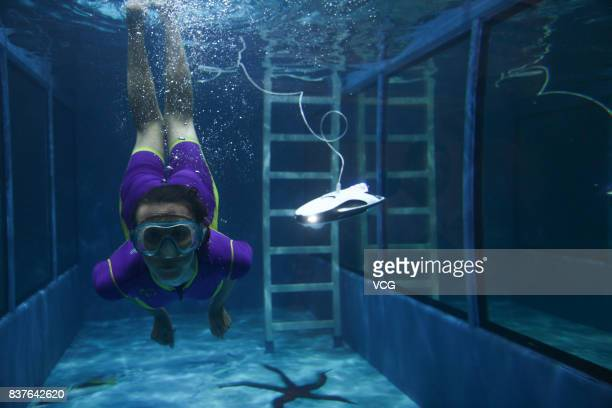 A robot shoots a diving performer at the World Robot Conference 2017 is held at Etrong International Exhibition Convention Center on August 22 2017...