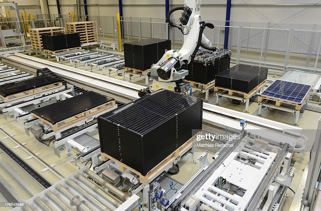 A robot sorts out finished solar energy moduls at the end of the assembly line at the Solarworld plant on August 14, 2013 in Freiberg, Germany. The troubled solar cells, modules and panels producer managed to recently avoid bankruptcy by reaching an agreement with its shareholders and other investors. Many solar energy equipment producers in Germany are facing difficult times due to stiff competition from China.