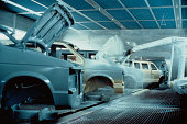 Robot  Sprays Cars in Factory