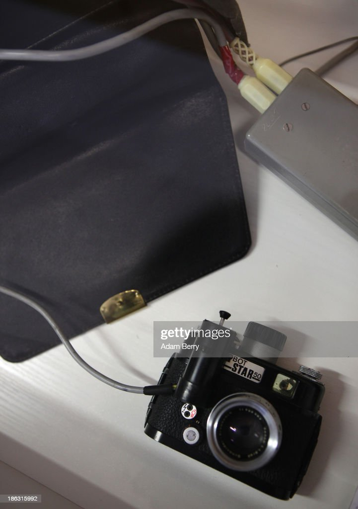 A Robot Star 50, a spy camera frequently used by the Stasi, is displayed connected to the bag in which it was hidden, where it was connected to an infared flash and flash battery for taking discreet night photographs, on display at the Stasi (Staatssicherheit), or East German Secret Police Museum, on October 30, 2013 in Berlin, Germany. German officials have maintained that they had strong evidence indicating that the American Nation Security Agency (NSA) has eavesdropped on Chancellor Angela Merkel's mobile phone, surveillance that the U.S. has since claimed is essential to its security operations and is standard procedure. The charge has caused a furor among political leaders across Europe, but is particularly troublesome to those who, like Merkel, grew up in the former East Germany and have recent memories of being spied upon by their own government. In response to anger over the matter from Germany, Mexico, France, Spain and Brazil ,the U.S. Senate Intelligence committee is currently conducting a major review of such surveillance operations, while the NSA insists that any such data collected on ordinary citizens turned over to the agency had been conducted by the local allied governments themselves.