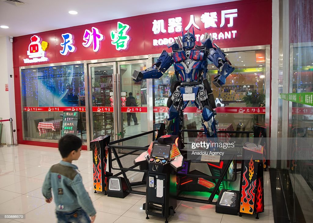 Robot waiters are seen working at a robot restaurant in Kunshan, China on May 22, 2016. The restaurant has a total of 10 robots in heights of 1.2 meters. Each robot costs 50,000 yuan and all used for delivery and cooking.
