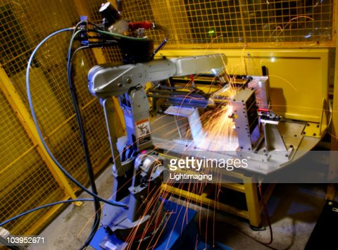 Robot Welding with Spaks Flying : Stock Photo