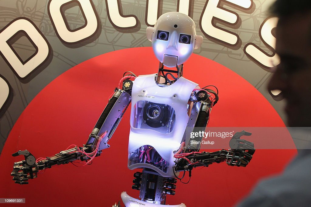 A Robothespian communications and entertainment robot interacts with visitors at the CeBIT technology trade fair on March 1, 2011 in Hanover, Germany. CeBIT 2011 will be open to the public from March 1-5.