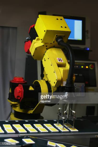 Robotic arm on assembly line