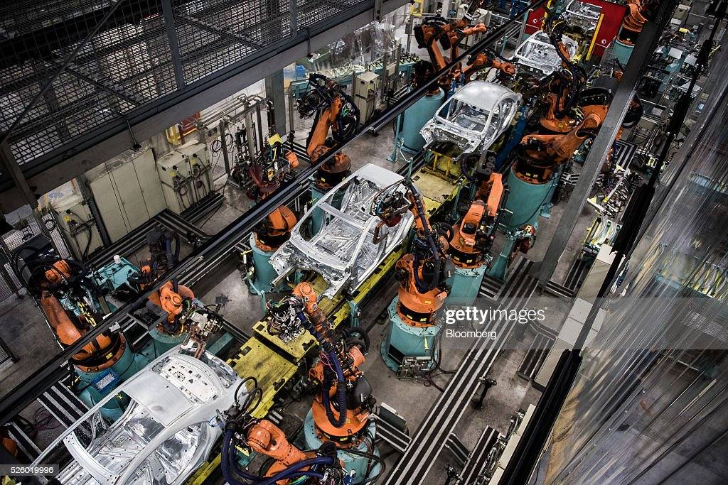 Robotic arms assemble automobile chassis on a production line inside the Mercedes-Benz AG automobile plant, operated by Daimler AG, in Kecskemet, Hungary, on Friday, April 29, 2016. Daimler's Mercedes factory will produce a new generation of compact vehicles, totalling Daimlers investment in Hungary to more than $1.8 billion. Photographer: Akos Stiller/Bloomberg via Getty Images