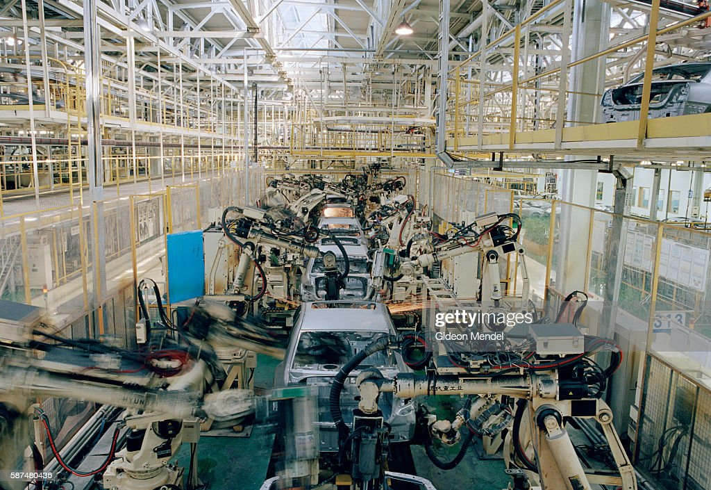 Robotic arms weld car frames at the Hyundai factory in Beijing Despite the fact that labour is cheap in Beijing the company has opted for automated...