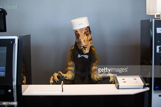 A robotic dinosaur replaces human staff at the check in counter at the Henna Hotel in Huis Ten Bosch Netherlands themed amusement park on July 15...