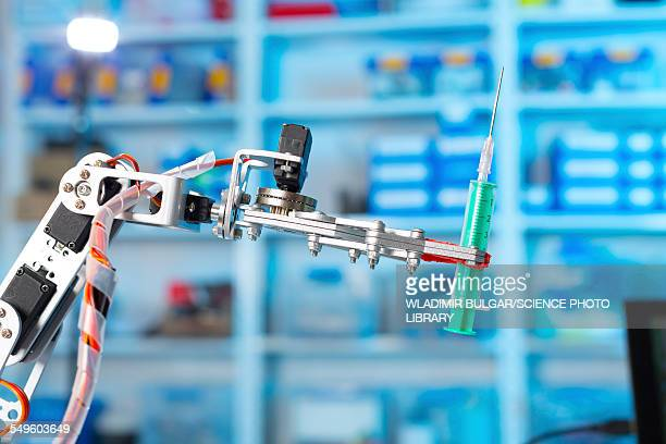 Robotic equipment holding syringe in lab