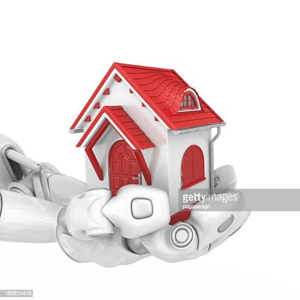 Robotergestützte Hände holding house