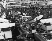 Robotic welding equipment on the General Motors Vega production line in action The automatic welding equipment places 95 % of the 3900 welds on each...