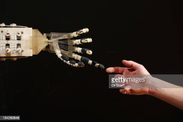 Robotics student Gildo Andreoni interacts with a Dexmart robotic hand built at the University of Bologna in the Robotville exhibition at the Science...