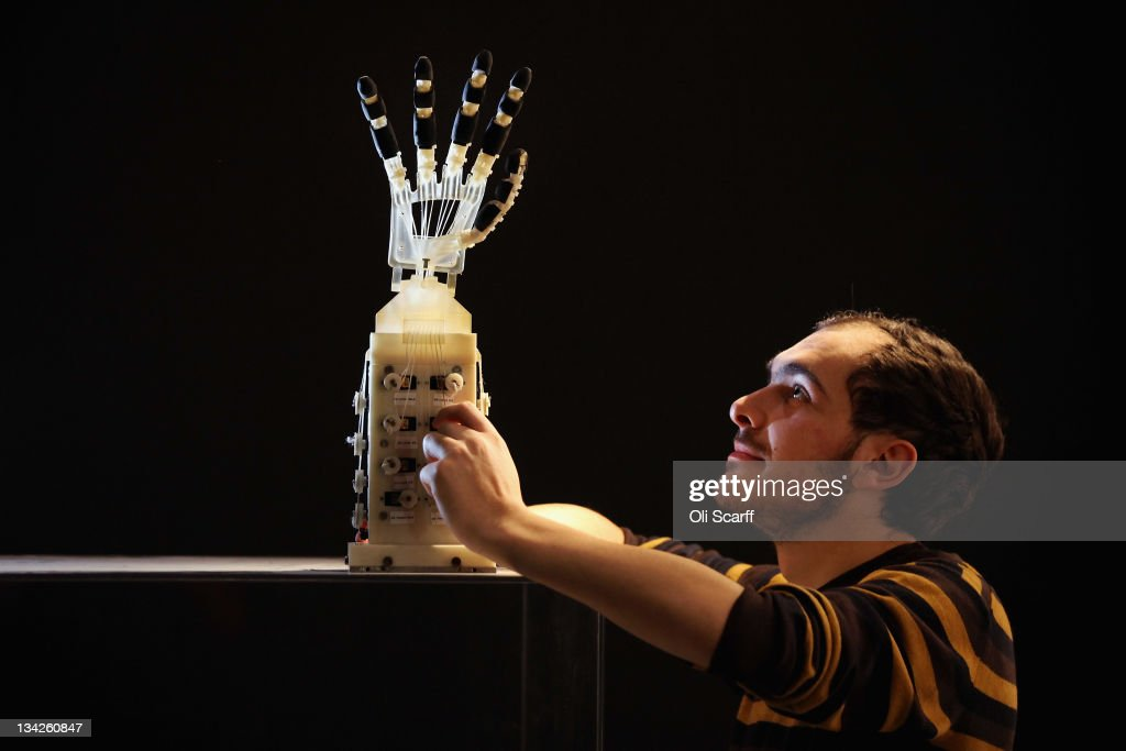 Robotics student Gildo Andreoni works on a Dexmart robotic hand built at the University of Bologna in the Robotville exhibition at the Science Museum on November 29, 2011 in London, England. The Science Museum's Robotville exhibition showcases 20 unique and cutting-edge robots from European research laboratories, it is free to enter and runs from December 1-4, 2011.