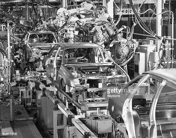 Robots and multiwelders at work spotwelding the bodyshells of Ford Sierra cars at a Ford factory May 1984