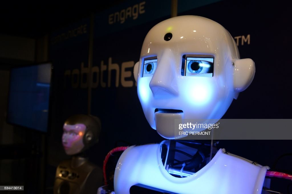 Robots are presented at the Robotics event Innorobo in La Plaine Saint-Denis on May 26, 2016. / AFP / ERIC