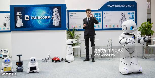 Robots are seen at the Tanscorp stand at the Cebit technology fair in Hannover on March 20 2017 The Digital Business fair CEBIT in Hanover with Japan...