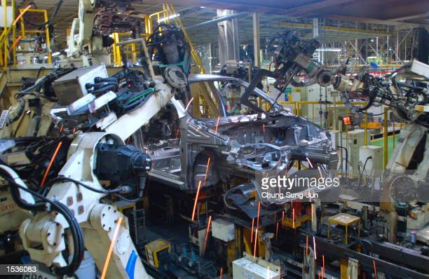 Robots assemble a new GM Daewoo vehicle the KALOS at the Bupyung plant October 28 2002 in Inchon west of Seoul South Korea GM formally launched in...