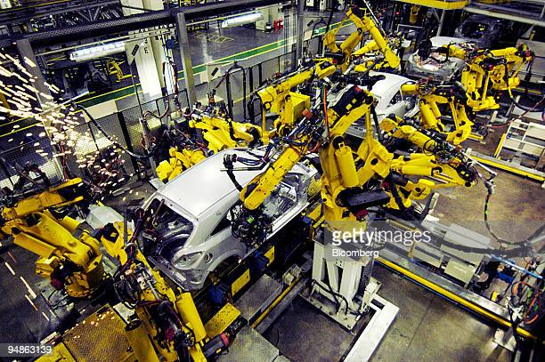Robots assemble Opel Astra cars at the General Motor plant in Antwerp Belgium Wednesday October 26 2005