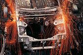 Robots assembling cars on production line
