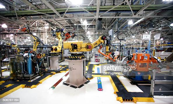 Robots at the Fiat Chrysler Automobiles US Warren Stamping Plant are shown January 22 2016 in Warren Michigan FCA US officially dedicated the new...