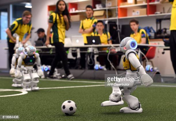 Robots battle it out for the soccer ball in Sydney on July 21 as Australias fivetime world champions of robot soccer the University of New South...