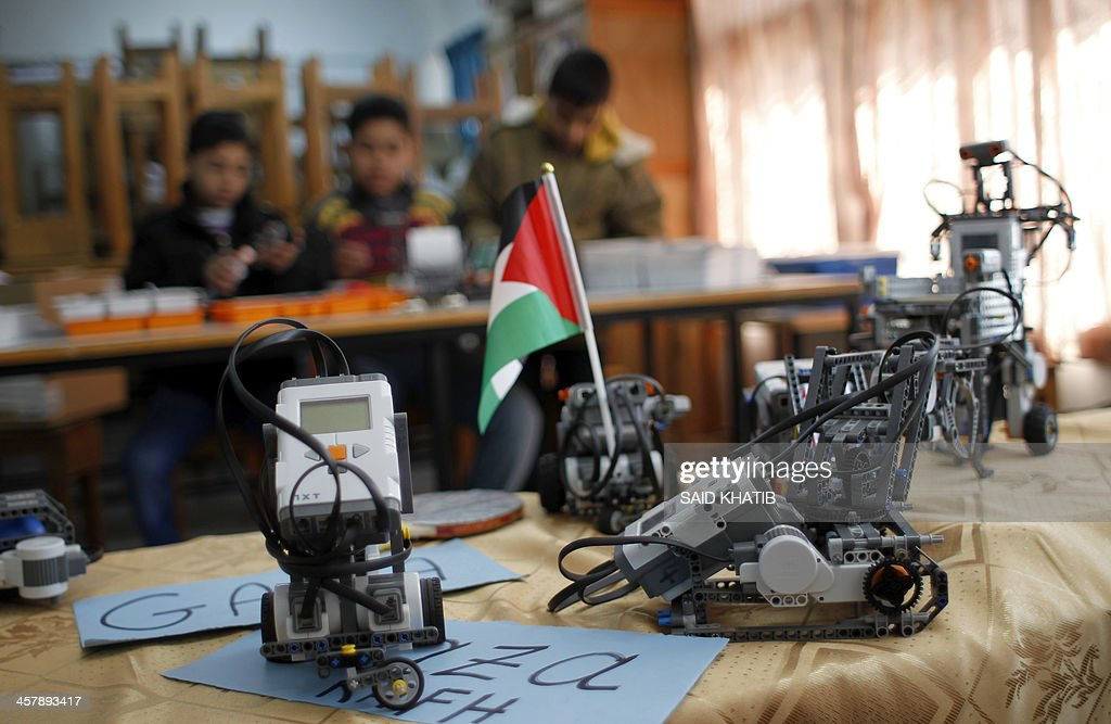 Robots built from Lego bricks are seen during a robotics workshop for Palestinien school students organised by the United Nations Relief and Works Agency for Palestine Refugees (UNRWA) in Rafah town, in the southern Gaza Strip, on December 19, 2013.