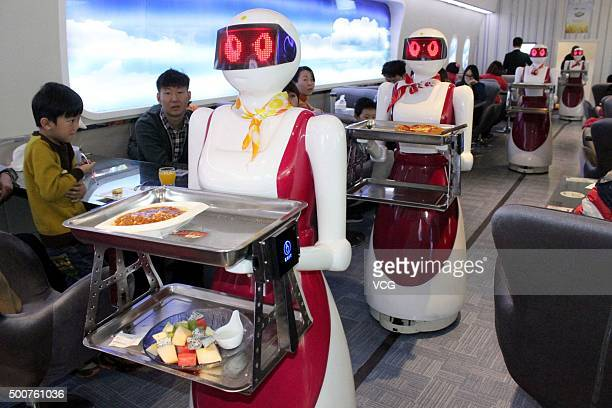 Robots deliver meals for customers at a restaurant on December 10 2015 in Suzhou China The restaurant owns four robots of delivering meals one robot...