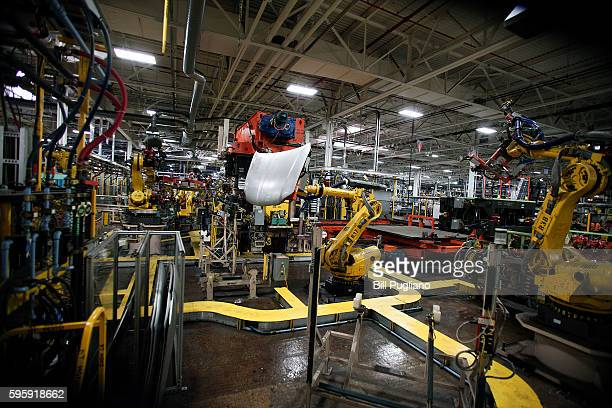 Robots handle parts for Fiat Chrysler Automobiles at the FCA Sterling Stamping Plant August 26 2016 in Sterling Heights Michigan An event was held...