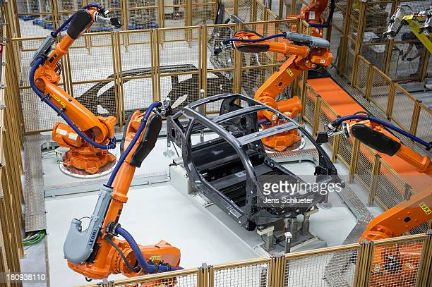 Robots manufacture a carbon chassis of a new BMW i3 electric car on the assembly line at the BMW factory on September 18 2013 in Leipzig Germany The...