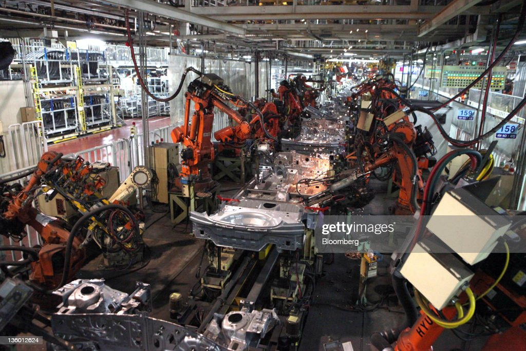 Robots perform welds on the production line of the Hyundai Motor Co Ulsan factory in Ulsan South Korea on Monday Dec 19 2011 Hyundai Motor Co South...