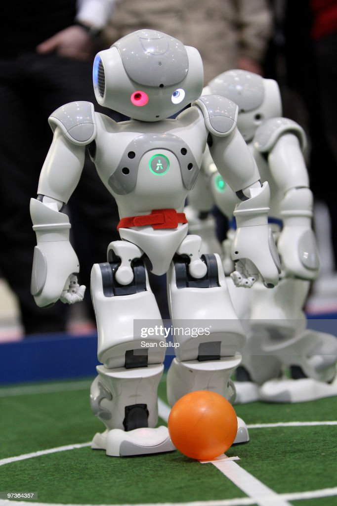 Robots play football in a demonstration of artificial intelligence at the stand of the German Research Center for Artificial Intelligence (Deutsches Forschungszentrum fuer Kuenstliche Intelligenz GmbH) at the CeBIT Technology Fair on March 2, 2010 in Hannover, Germany. CeBIT will be open to the public from March 2 through March 6.