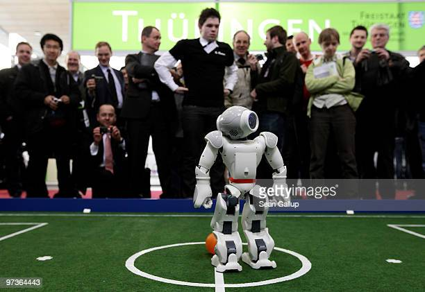 Robots play football in a demonstration of artificial intelligence at the stand of the German Research Center for Artificial Intelligence at the...