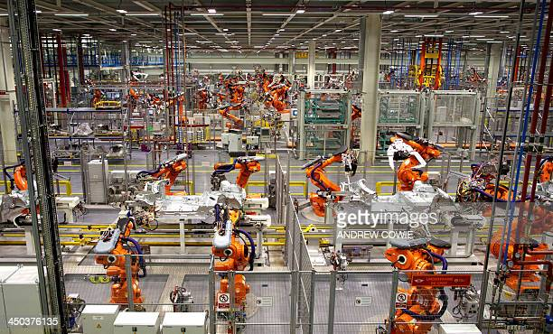Robots ready to produce the new Mini Cooper are pictured during a tour of the BMW's plant at Cowley in Oxford central England on November 18 2013 Car...