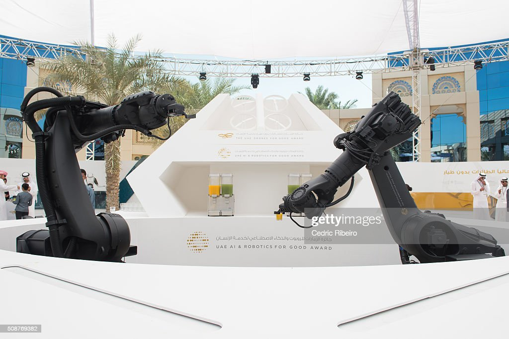Robots serve juice to audience during The UAE AI & Robotics Award for Good at Dubai Internet City on February 6, 2016 in Dubai, United Arab Emirates where the winners of the USD 1 million international competition and the AED 1 million national competition will be announced.