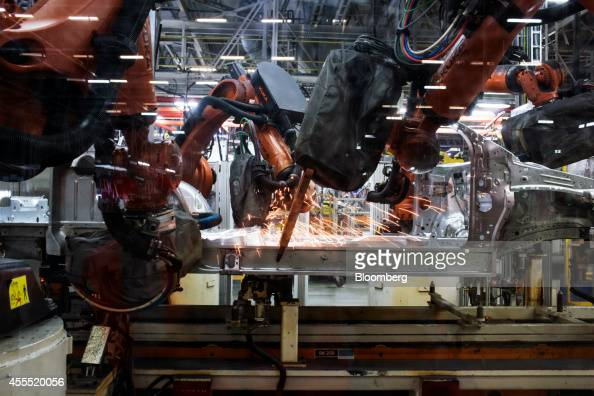 Robots weld the frame and chassis of a Volkswagen AG Vento automobile on the production line at the Volkswagen India Pvt plant in Chakan Maharashtra...