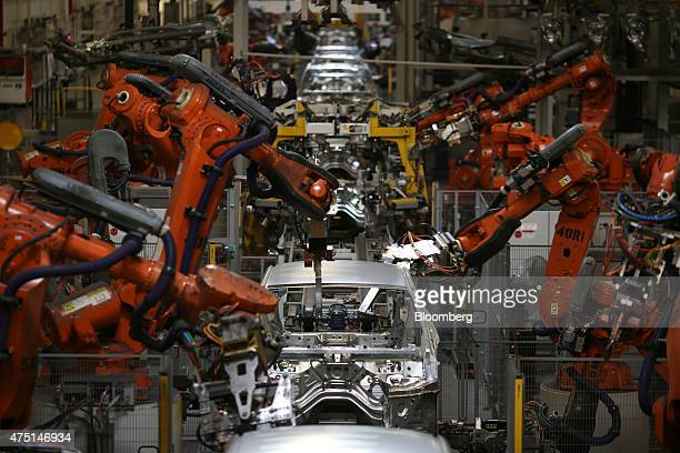 Robots weld together Bayerische Motoren Werke AG X4 sports utility vehicle body frames at the BMW Manufacturing Co assembly plant in Greer South...