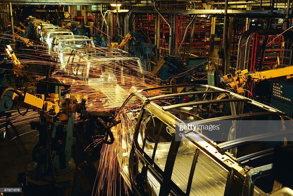 Robots weld van bodies at General Motors plant in Baltimore, MD