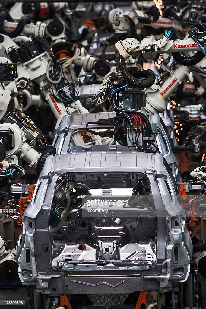 Robots weld vehicle bodies as they move through the body shop station on the production line & Production Inside A Ford Motor Co. Plant As GDP Figures Are ... markmcfarlin.com
