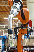 Robots welding in the automotive parts industry