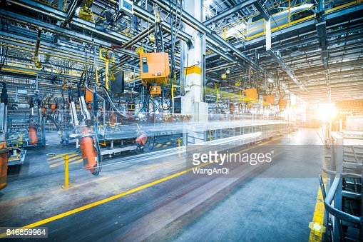 robots welding in a car factory : Stock Photo