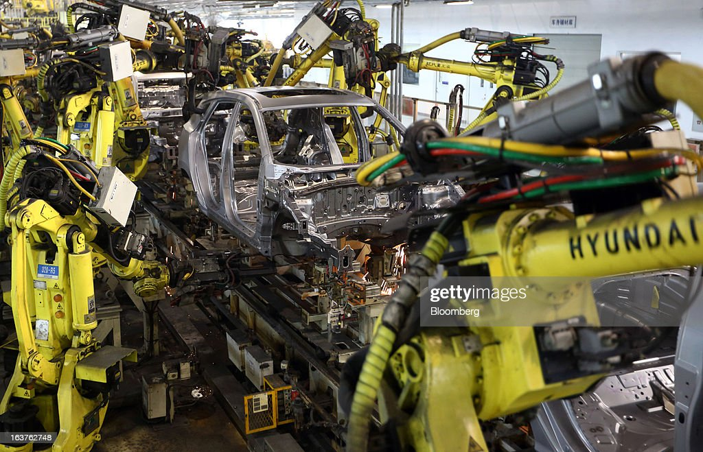 Robots work on the welding line at a Beijing Hyundai Motor Co. plant in Beijing, China, on Friday, March 15, 2013. The joint venture between Beijing Automotive Industry Holding Co. and Hyundai Motor Co., has three plants in the city, manufacturing 11 kind of models. Photographer: Tomohiro Ohsumi/Bloomberg via Getty Images