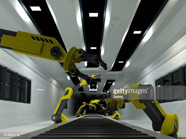 Robots working on factory production line